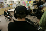 0017 Pat Termin, CQ, left, principal of Conifer High School, address the media during a press...