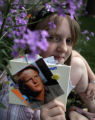 My Dad is a Hero Project. Kaitlyn Lempp  (cq), 10 holds a photo of her father, John Lempp, who...