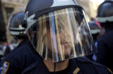 (08/29/2004 New York City)-A  New York City police officer dons riot gear Sunday, August 29, 2004,...