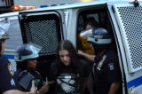 (08/29/2004 New York City)-A protestor is arrested Times Square Sunday, August 29, 2004, after...