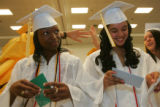 (from right) 18 Julissa Torrez (cq) and her friend, 18 year-old Simone Williams (cq) open a...