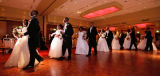 (Denver, Colo., June 2, 2007) Debutantes and their escorts parade around the dance floor before...