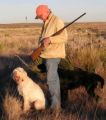 Ed Dentry photo for June 12, 2007  Hap Lundquist takes a break with Posey, his Spinone pointer,...