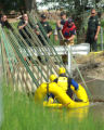 Members of the Grand Junction Fire Department Water Rescue Team work to recovery the body of John...