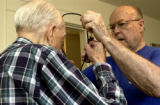 (BRUSH, Colo., April 23, 2004) Harold gets help finishing dressing from Stan with the help of his...