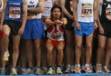 Jorge Salazar of Sleepy Hollow, NY stretches before the start of the 29th annual Bolder Boulder...