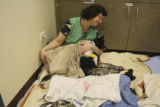 Peggy Risi, (cq), a Veterinary Clinic Volunteer, handles the recovery area and three of the...