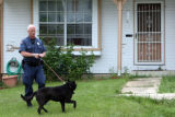 DLM5204  Aurora Police Officer Bob Day uses a dog to search the neighborhood for a weapon used by...