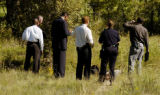 (DENVER Colo., August 30,2004) Denver police officers  check out a body of a homeless man that ...