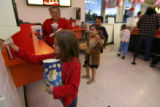 Essanze Aragon, cq, 6, pulls some napkins from a dispenser at the concession stand at the...