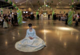 Norma Garcia (cq) waits patiently during the huge party her parents threw for her quinceanera for...