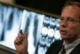 0526 Dr. Charles Daley, chief of infectious diseases, talks to the media about XDR TB, a stain of...
