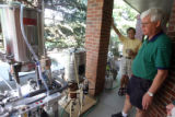 Home Brewers (l to R) Jim Edgins (cq)  and Art Ballah (cq) brew beer at Ballah'sHighlands Ranch...