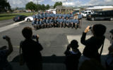0249 Family member takes pictures of the 22 Colorado State Patrol officers and staff who graduated...