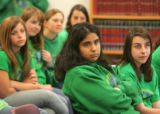 Students Miriam Kaykova (cq), 13, center, and Aylah Sroloff (cq), 13, right, and other students...