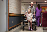 Rudy Ludemann (cq) pushes fellow hospice patient Karen Foster (cq) back to her room at the Hospice...