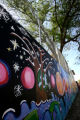 The mural painted by Brown Elementary School children, with the help of Temple Sinai teenagers,...