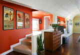 Bright orange walls add definition to the architecture in John Burr's place at 31st and Walnut St....