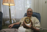 Herb Davis, 83, (cq) sits with his French Croix De Guerre patch at home at 3340 S. Oneida Way in...