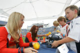 (from left) Denver Broncos cheerleaders, Kristina Hoyer (cq) and Rebecca Bolan (cq) sign...