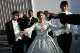 Norma Garcia (cq) gets dance instructions from instructor Luis Cisneros (cq), whose hand is to the...