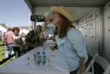 0141 Famous chef Claudine Pepin, of Denver, takes an uncouth swig of champaigne while signing her...