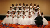 (Denver, Colo., June 2, 2007) James Rowe, lower right, organizes the debutantes for the formal...