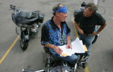 Lumpy Ordekowski (cq), owner of L2 Motorcycle rentals, talks with Tommy Mack (cq), president of L2...