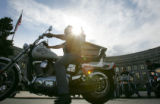 Tommy Mack (cq), president of L2 Motorcycle rentals, parks his bike in front of the City and...