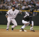 (DS-b-354) - Colorado Rockies second baseman Kazuo Matsui safely steals second base as New York...