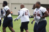 Denver Bronco defensive tackle #63 Sam Adams (cq) ,center, during mini training camp at Dove...