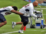 Denver Bronco defensive tackle #63 Sam Adams (cq) ,right, during mini training camp at Dove Valley...