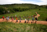 Barbara Stoner (cq) front adult, leads a group of kids from Dotties Day Care for a hike on a trail...