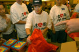 (8/31/04, New York, NY) Colorado delegate Flora Rohrs takes direction on what to put into bags...