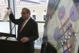 Evan Makovsky (cq), shows a map with a layout at right during his press conference. The Downtown...