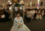 Norma Garcia (cq), looks at the altar in St. Mary's Catholic Church before her quinceanera mass...