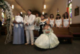 Friends and family members gather to participate in Norma Garcia's quinceanera mass held in St....