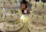 Abbileni Rodriguez, 5, from Marshalltown, Iowa, eyes the huge series of cakes for Norma Garcia's...