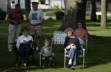 Great-grandmother Geri Kuhl (cq), left, sits with her great-grandson Holden Lane, 5, and her...