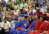 The Marshalltown High School Class of 2007 waits patiently in the school gymnasium during the...