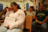 Sonia Rojas, cq, of Denver, wipes away tears during a citizens' group, Congregation Building...