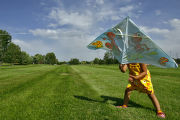 DLM1734  The wind whips around Maya Wilson, 3, as she tries to fly a kite at Robert F. Clement...