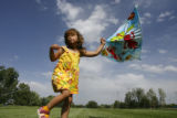 DLM1736  The wind whips around Maya Wilson, 3, as she tries to fly a kite at Robert F. Clement...