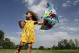 DLM1737  The wind whips around Maya Wilson, 3, as she tries to fly a kite at Robert F. Clement...