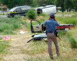 A Colorado State Trooper photographs the accident were a child was killed Wednesday June 6, 2007...