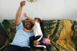 Gustavo Puga (cq), left, plays with his daughter Noelia Puga (cq), 3, right, at their home in...