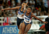 (ATHENS, GREECE-AUGUST 27, 2004) United States' Marion Jones, left, and Lauryn Williams, right,...