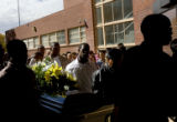 Manual students and pallbearers from the Taylor Funeral Crematorium Services carry a casket into...