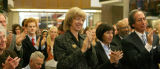 Colorado Attorney General, Gail Norton, center, applauds the former U.S. Supreme Court Justice,...