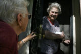 71 year-old Nell Croswhite (cq) talks to Maudie Luddington (cq), after delivering her a few boxes...